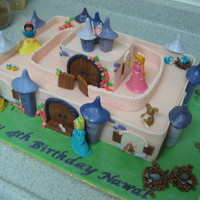 Princess Castle   4 Disney Princesses in their castle. A variation on a Debbie Brown caslte design. Vanilla sponge and MMF