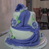 Elegant Fondant Class This is my cake for the wilton elegant fondant class. It was a lot of fun to decorate.