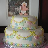 Clothesline Baby Shower Cake from the wilton yearbook (2006 I think). The baby on top is made of gumpaste. Covered in marshmallow fondant with marshmallow fondant...