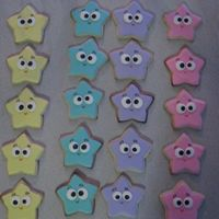 Dora Star Cookies Cookies I made to go with the Dora Cake. Eyes are colour flow, details using icing writers.