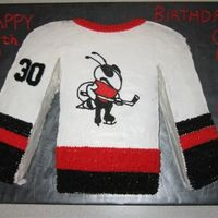 "Hockey Jersey Cake Cake for a 6 year old based on his hockey jersey. Covered in buttercream. Cut from a 16"" square cake."