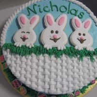 Easter Birthday Cake An easter themed birthday cake for my 5 year old cousin whose birthday was on Easter weekend. Bunnies are rolled cookies with royal icing....