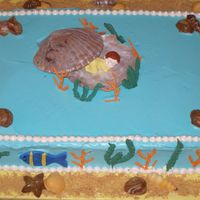Fish Themed Baby Shower Cake   butter cake with strawberry filling and Whimsical Bakehouse buttercream. Chocolate shells, fondant fish, royal icing sea weed.