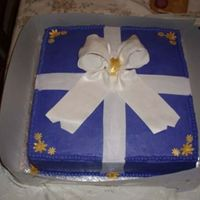 Joanne's Retirement Cake   WASC with buttercream frosting. My first gumpaste bow and fondant ribbon.