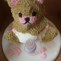 Baby Bear Cake   Baby bear cake with baby feet and bottle on cake board.