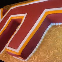 Virginia Tech Cake   The groom went to Virginia Tech so I made the VT logo into a cake! The layers inside the cake were also orange and gold!