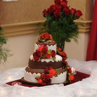 Fall Wedding Cake White and chocolate fondant cake; chocolate cake with chocolate ganache and caramel fillings. Roses are gumpaste.