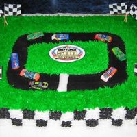 Daytona 500-Gentlemen, Start Your Engines!  I made this for a Daytona 500 party. My hubby helped me with the flags, the logo in the middle, and the cars. He is a huge racer! Have to...