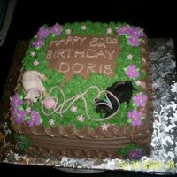 Cats   82nd birthday cake chocolate fudge with chocolate mousse, and chocolate buttercream. cats are made of fondant as well as yarn