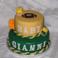 Football Baby Shower My first tiered cake. Made cake for my friends baby shower a Football theme, her husband is a Green Packer fan.