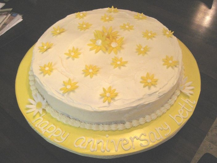 "Anniversary Cake W/ Fondant Daisies   14"" round choc cake w/ cream cheese icing. Fondant daisies. Super easy and very cute."