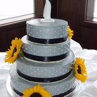 Grey Wedding Cake The brides theme was starry night. Grey cream cheese frosting, dark blue ribbon, fresh yellow sunflowers