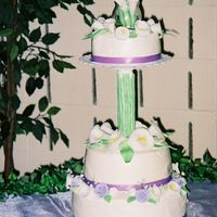 Calla Lily Cake This is a cake for a 10th anniversary celebration. The calla lillies and leaves were made from fondant and the stems were made from a...