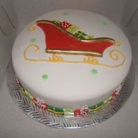 Sleigh Full Of Presents A fondant covered cake with royal icing and fondant presents