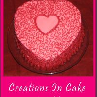 Pink & Red Heart   White cake with Raspberry filling. Pink butter cream and red buttercream detail.
