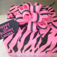 Pink And Black Zebra Buttercream iced w/fondant stripes and bow.