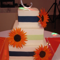 Burnt Orange Sunflowers Buttercream iced w/fondant ribbons and gumpaste sunflowers.
