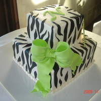Zebra Stripes With Lime Green Buttercream iced w/fondant bow and stripes. For an 80th birthday.