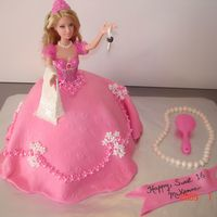 Barbie Sweet 16 Cake Sweet 16 who wanted a princess/barbie cake, holding a sugarpaste car key.