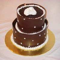 Chocolate Wrap Wedding This is a choclate cake filled and frosted with Toba Garrett's Chocolate frosting and then wrapped with a chocolate wrap. RI roses on...