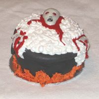 Zombie Rise The cauldron is chocolate pound cake covered in chocolate BC then Fondant. Fire, Froth, and Blood in royal icing. The zombie is MMF. This...