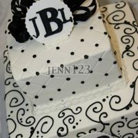 50Th Birthday Tiered birthday for a man. Buttercream, florists ribbon, fondant monogram