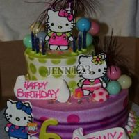 Hello Kitty Tiered cake for a friend's child. Fondant kittys