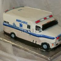 Ambulance Groom's cake for EMT. Designed from photos of his vehicle. Red Velvet and faux cream cheese (Lorann cheesecake flavoring in...