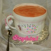 "Tea Cup 3 layer 8"" carved to shape. buttercream icing, fondant rim, gum paste handle, piping gel tea. The real spoon is a prop for the picture..."