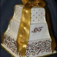 Fondant Gold Bow With Buttercream I use my airbrush to apply the gold (Luck's Shimmer Airbrush color Cakedeco.com). I colored the fondant a gold color to start with...