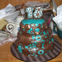 "Teal And Brown Circle Cake 10"" and 6"" are white butter cake w/ raspberry mouse filling. 8"" is choc. butter cake w/ raspberry mouse filling. All is..."