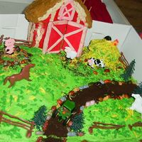 Pony/farm Cake THis cake gave me soooo much head ache. I was determined to get the 3d barn to sit on the slab cake. THe slab was not dense enough to...