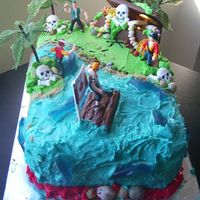 1St Pirate Island Cake This is a cake I did for my best friend's son's birthday! He requested a skull and cross bone cake...with persuation he was...