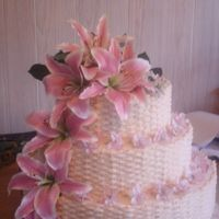 Basketweave Wedding Cake W/ Lilies I really enjoyed doing this cake. The bride picked out pretty flowers & made it a little easier for me! I really want to thank...