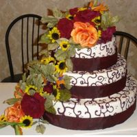 Red_Wedding_Cake.jpg I had a terrible time with this cake. I'm glad its over with and I just hope the bride likes it.