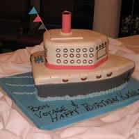 Birthday Cruise Ship   This is a fondant covered two tier birthday cake in the shape of a cruise ship.