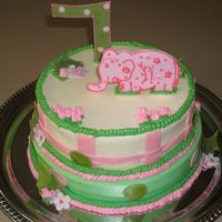 Lilly Pulitzer Cake   2 tiered butter cream with gum paste elephant and number 7. Based on invitations by Lilly Pulitzer.