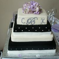 "Black And White Wedding Cake   Cake for about 175 people in buttercream with fondant ""ribbons""."