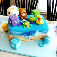 Baby Toys Chocolate cake with roasted almond cover MMF. evrything edible accept support.