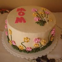 Spring Birthday had to find a way to use some practice flowers. Thanks to Krazykakes for the inpsiration and support. Its is a pineapple cake with cream...