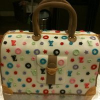 Casey's Birthday Cake WASC with French Vanilla Buttercream. The birthday girl really loves purses, so this is what I came up with. Thanks for looking. :-)