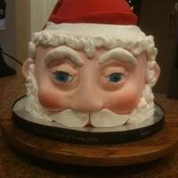 "Santa Claus  This is an 8"" round (double layered) WASC with French Vanilla BC and rolled fondant. The face is sculpted from fondant. Thanks for..."