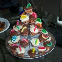 Cupcake Tower This was a big hit at a recent pool party. Wilton 23 place holder. White and chocolate bc, butter/pecan cupcakes. Jelly candies as...