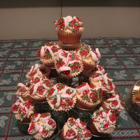 Christmas Cupcakes white cake with apricot/Grand Marnier filling. Buttercream frosting. Marshmallow flowers.