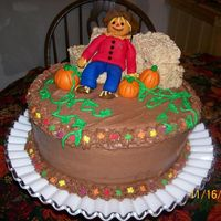 Fall Chocolate cake with chocolate bc. Rice krispies hay bales and first time fondant figure and pumpkins. Idea from this site, of course....