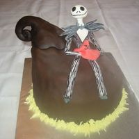 Jack Skellington Halloween Cake Red velvet cake, shaped to look like a spooky hill, and covered in chocolate fondant. Jack Skellington figure is hand-made out of gumpaste...