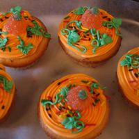Autum Cupcakes Just made these up... french vanilla cupcakes,butter cream icing and candy pumpkin on top :)