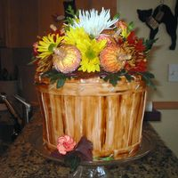 Fall Basket This is a bushel of flowers with ornamental pumpkins added to the arrangement. I have seen this design on this site, and thought that it...