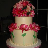 Roses And Daisies I found this design on this site and I loved it! I was given free reign over this cake design, so here it is! It was for a wedding shower...