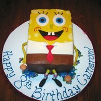 Spongebob Squarepants I did this cake for a little girl that is frilly, but loves Spongebob also! I decided to add some flowers and gummy hamburgers around him....
